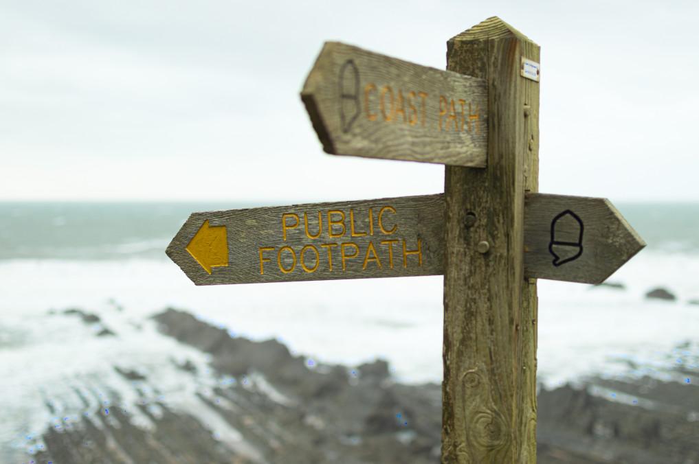 A sign post on a beach